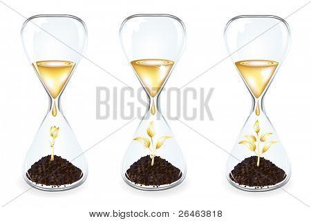 Glas Uhren mit goldenen Sprossen, Münzen und Goldene Tropfen, isoliert auf weiss