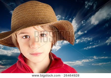 serene child with straw hat
