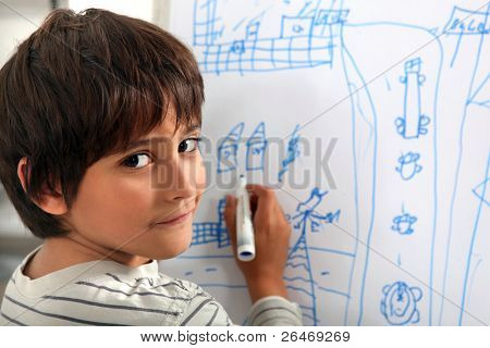 Child drawing a street scene