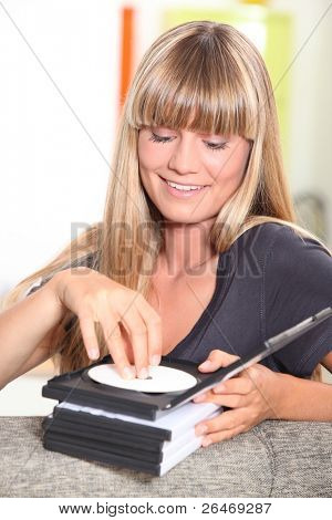 fair-haired damsel with CDs