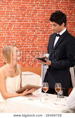 Woman ordering at a restaurant