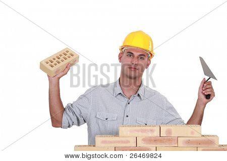 A mason building a wall.