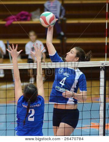 KAPOSVAR, HUNGARY - OCTOBER 23: Petra Horvaths (R) in action at a Hungarian NB I. League woman volleyball game Kaposvar vs Bekescsaba, October 23, 2011 in Kaposvar, Hungary.