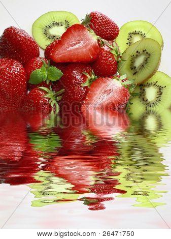 Strawberry and kiwifruit on white background