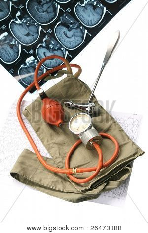 Old blood pressure cuff isolated on white background