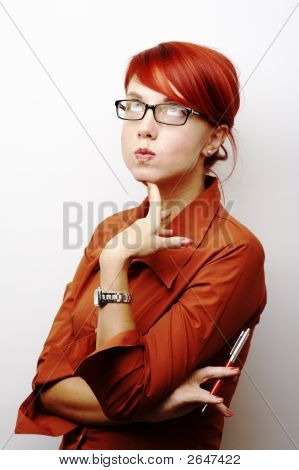 Portrait Of Pensive Business Woman