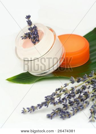 Moisturizing face cream with lavender on white background