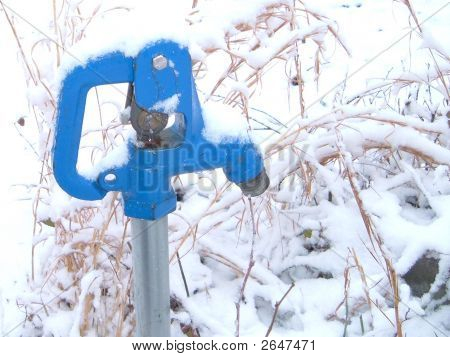 blue water hydrant in the snow