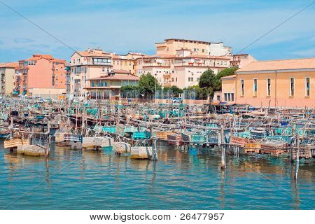 Fishing traps and anchored fishing boats in port. Chioggia - Italy