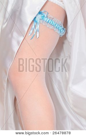 Beautiful wedding garter on leg