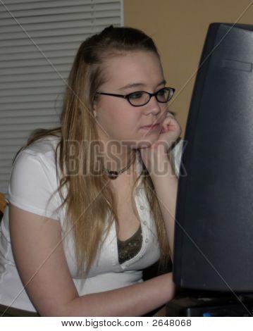 Teenage Girl At The Computer