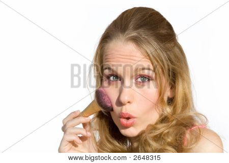 Young Woman Putting On Makeup