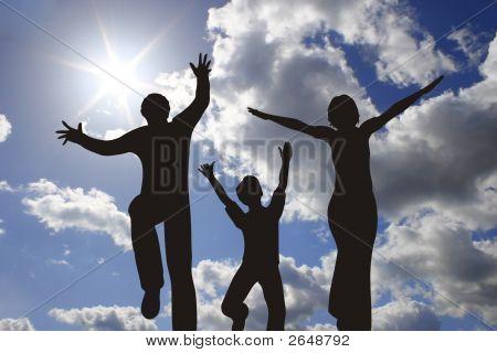 Happy Family Silhouette On Sunny Sky