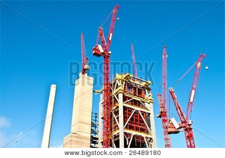 Cranes and the Boiler building of a new power plant construction site in Mannheim in Germany