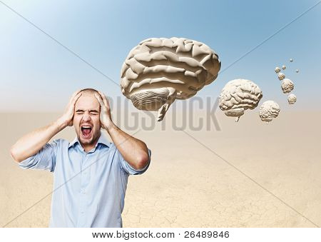desperate businessman and 3d brain in desert