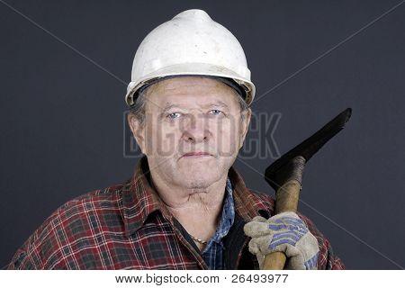 Portrait Of Senior Logger On Black