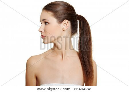 Front view portrait of a young beautiful female caucasian teen having naked arms, looking to the site, on white.
