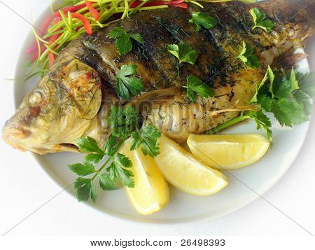 fried fish with fresh herbs and lemon