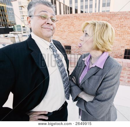 Woman Sticking Out Her Tongue At Coworker Or Boss