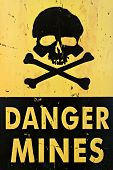 danger mines - old sign warning of land mines or minefield, closeup