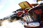old cars in the snow at a rural junkyard. shot with a lensbaby - limited depth of field with focus o
