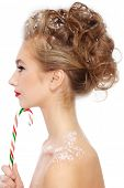 image of dandruff  - Profile of young beautiful girl with fancy stylish hairdo and candy cane in hand - JPG