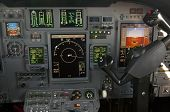 stock photo of yoke  - Corporate jet cockpit view with digital instruments - JPG