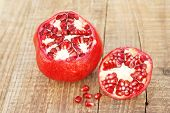 Pomegranate Fruit Isolated. Pomegranate Grains. Pomegranate Close Up On Wooden Table. poster