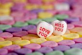 image of miss you  - Valentine hearts LOVE and MISS YOU on rows of colorful hearts with narrow focus range - JPG
