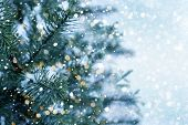 Closeup Of Christmas Tree With Light, Snow Flake. Christmas And New Year Holiday Background. Vintage poster