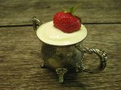 Ripe Strawberries In Sour Cream Are Placed In A Silver Sugar Bowl, Which Stands On An Oak Table. Rip poster