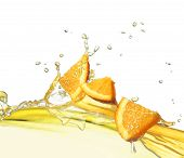 picture of orange-juice  - orange slice in juice stream - JPG