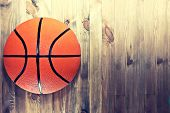 Basketball Ball On Wooden Hardwood Floor In The Basketball Court. Retro Vintage Picture. Sport Conce poster