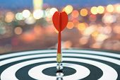 Red Dart Target Arrow Hitting On Bullseye Over Blurred Bokeh Light Background, Metaphor To Accuracy  poster