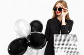 Elegant Woman Wearing Sunglasses In A Black Dress And Red Lips, In The Hands Of Bags For Shopping An poster