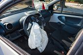 Interior Of Crashed Car After Accident With Deflated Airbags On Road In City, Sunny Day poster