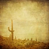 Grunge Background With Wild West Landscape.