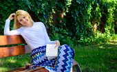 Woman Happy Smiling Blonde Take Break Relaxing In Garden Reading Poetry. Lady Enjoy Poetry In Garden poster