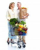 stock photo of grocery-shopping  - Senior couple with a grocery shopping cart - JPG