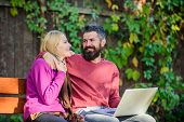 Surfing Internet Together. Couple With Laptop Sit Bench In Park Nature Background. Family Surfing In poster