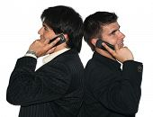 image of people talking phone  - Two young businessmen talking on their mobile phones - JPG