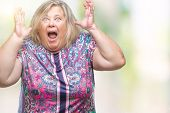 Senior plus size caucasian woman over isolated background celebrating crazy and amazed for success w poster
