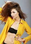 image of windswept  - Sensual woman model with windswept flying brown hair - JPG