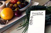 Grocery List Shopping List On Kitchen Counter With Healthy Vegetables, Kale, Tomatoes, Fruit, Fresh  poster