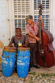 TRINIDAD, CUBA - CIRCA OCT 2008: Traditional musicians play in the street circa October 2008 in Trin