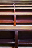 foto of pews  - Close up of pews inside a Catholic Church - JPG