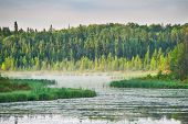 A Lake In Prince Albert National Park In The Early Morning Hours. poster