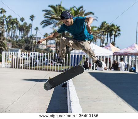 OCEANSIDE, CALIFORNIA - AUGUST 19: Skateboarder Alex Garcia practices aerial tricks on his board on August 19, 2012 in Oceanside, California.
