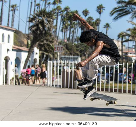 OCEANSIDE, CALIFORNIA - AUGUST 19: Skateboarder Carlos Chavez practices aerial tricks on his board on August 19, 2012 in Oceanside, California.