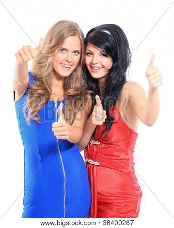 two young women showing thumbs up